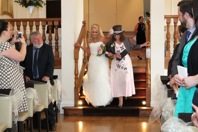 english real wedding mum walks down the isle with bride