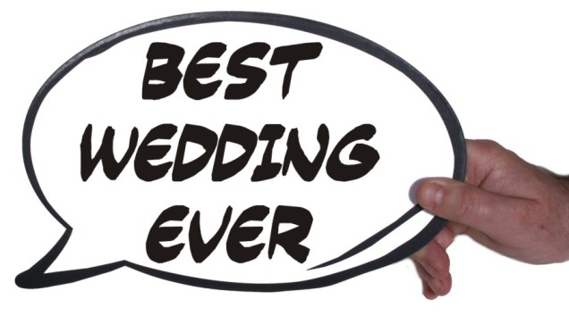 Holding Best Wedding Ever sign Photo Shoot booth dress up props
