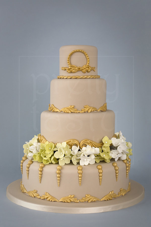 wedding cake gold and beige with flowers architectural - Pretty Tasty UK